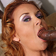 eight hung blacks sharing busty redhead MILF Janet Mason from Blacks on Blondes